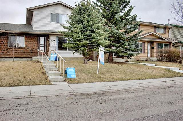 329 Woodvale Crescent SW, Calgary, AB T2W 3L3 (#A1093334) :: Redline Real Estate Group Inc