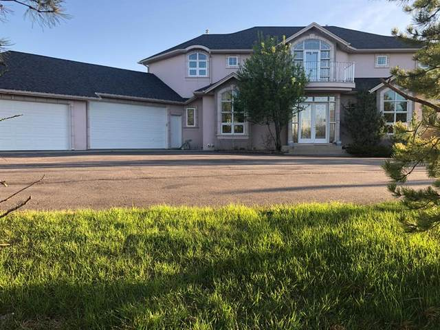 19 Blueridge Place NW, Rural Rocky View County, AB T3L 2N5 (#A1099414) :: Calgary Homefinders