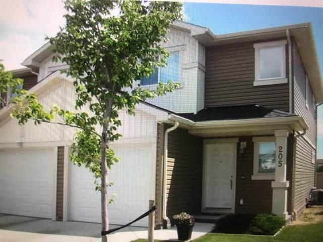 205 Silkstone Road W #1, Lethbridge, AB  (#A1104974) :: Redline Real Estate Group Inc