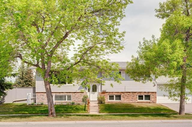 184 Woodridge Drive SW, Calgary, AB T2W 3S6 (#A1107649) :: Western Elite Real Estate Group