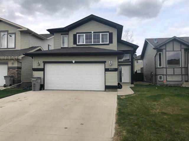 8830 88 Avenue, Grande Prairie, AB T8X 0G6 (#A1108179) :: Canmore & Banff