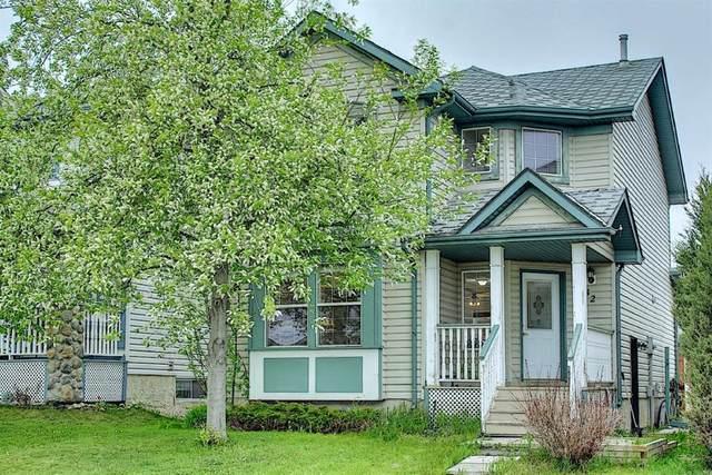 82 Hidden Hills Road NW, Calgary, AB T3A 5Y2 (#A1113155) :: Calgary Homefinders