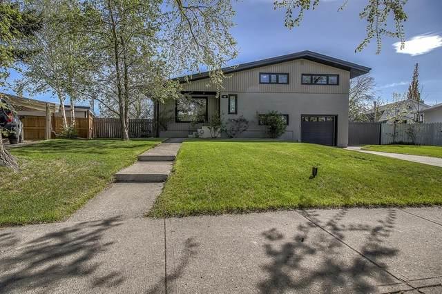 68 Warwick Drive SW, Calgary, AB T3C 2R4 (#A1113277) :: Calgary Homefinders