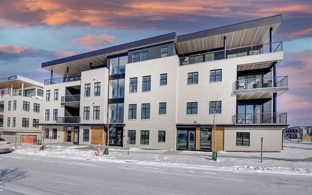 235 Lebel Crescent Nw #202, Calgary, AB T3B 3G6 (#A1113901) :: Calgary Homefinders