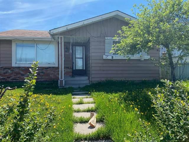 5315 Madigan Drive NE, Calgary, AB T2A 5T5 (#A1115940) :: Calgary Homefinders
