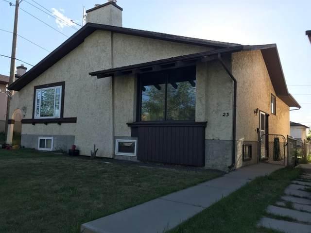 23 Bermuda Drive NW, Calgary, AB T3K 2B2 (#A1116067) :: Calgary Homefinders