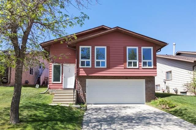 51 Berkshire Road NW, Calgary, AB T3K 2A2 (#A1116511) :: Calgary Homefinders
