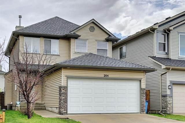 204 Saddlecrest Way NE, Calgary, AB T3J 5N2 (#A1116835) :: Calgary Homefinders