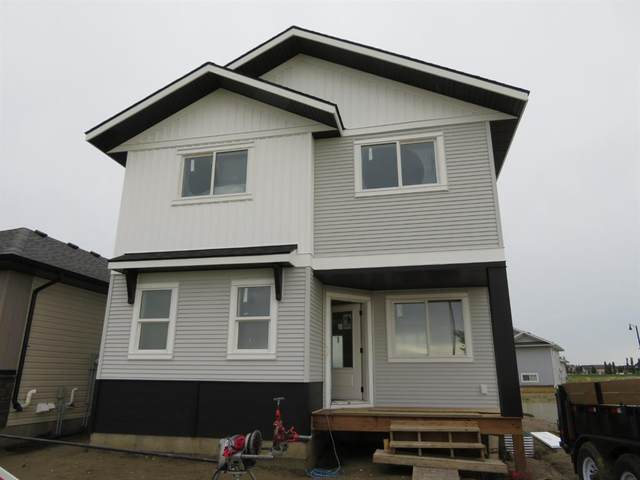 36 Oxford Boulevard, Penhold, AB T0M 1R0 (#A1118420) :: Calgary Homefinders