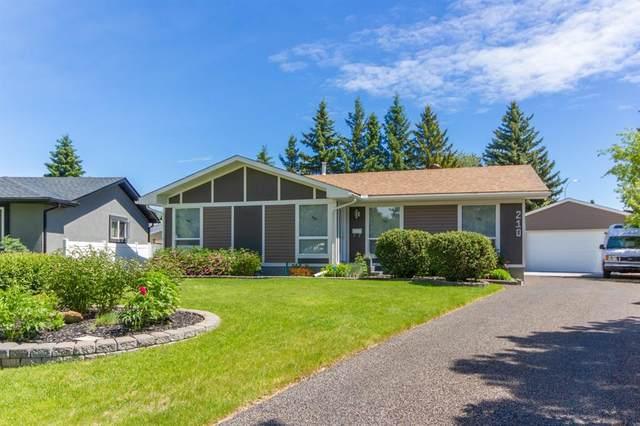 210 Oakmoor Place SW, Calgary, AB T2V 4A4 (#A1118445) :: Western Elite Real Estate Group