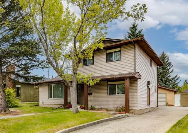 8111 Hunterview Drive NW, Calgary, AB T3K 1B2 (#A1118724) :: Calgary Homefinders