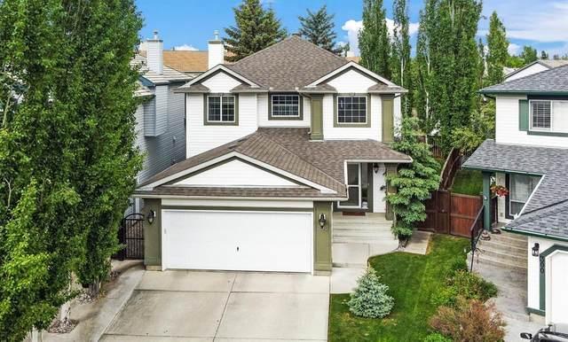 296 Mt. Brewster Circle SE, Calgary, AB T2Z 3J2 (#A1118914) :: Calgary Homefinders
