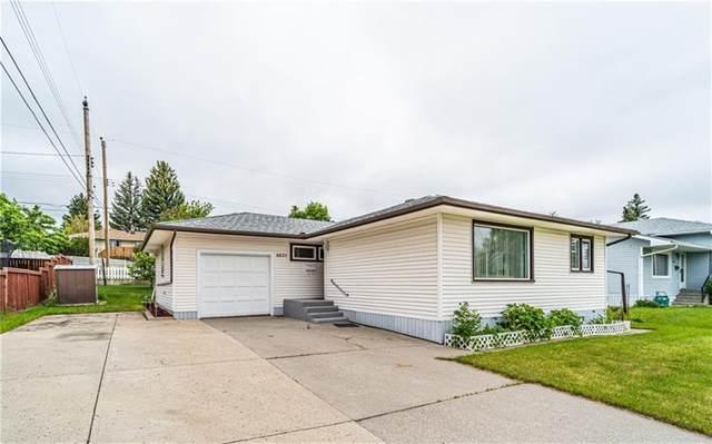 6023 Thornbank Drive NW, Calgary, AB T2K 3P4 (#A1120163) :: Calgary Homefinders