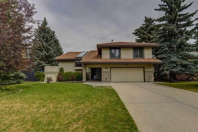 512 Coach Grove Road SW, Calgary, AB  (#A1127138) :: Calgary Homefinders