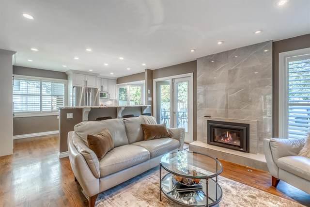 436 Lake Moraine Road SE, Calgary, AB T2J 1E6 (#A1148618) :: Western Elite Real Estate Group