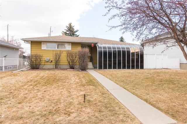 15 Governor Drive SW, Calgary, AB T3E 4Y6 (#C4237999) :: Redline Real Estate Group Inc