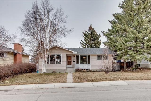 7732 Hunterquay Road NW, Calgary, AB T2K 4T8 (#C4238726) :: Canmore & Banff