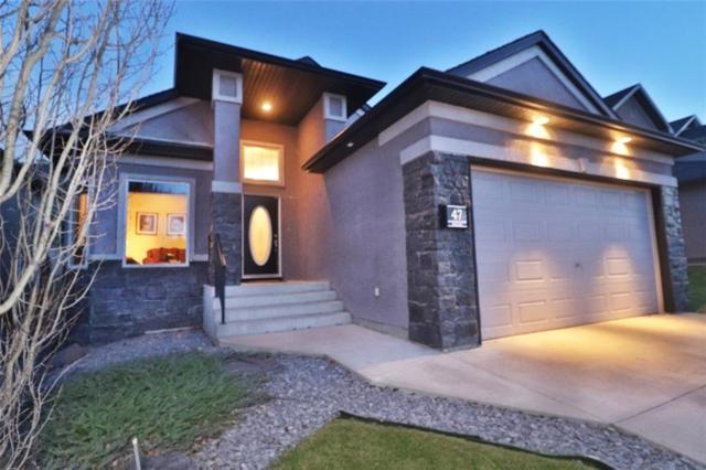 47 Evercreek Bluffs Road SW, Calgary, AB T2Y 4P3 (#C4239688) :: The Cliff Stevenson Group
