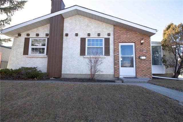 47 Cedar Ridge Place SW, Calgary, AB T2W 1X7 (#C4241131) :: Redline Real Estate Group Inc