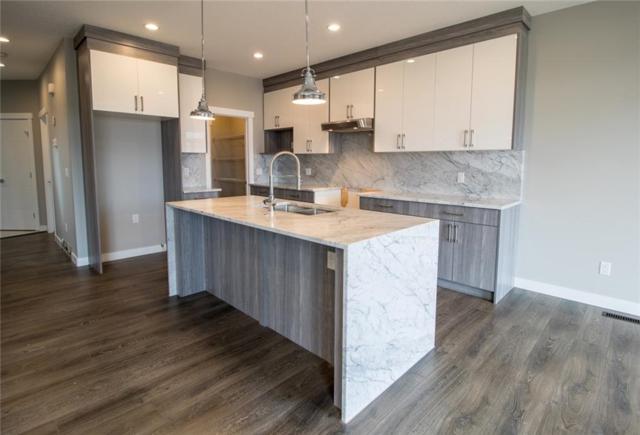 857 Hampshire Crescent NE, High River, AB T1V 0E4 (#C4241336) :: Western Elite Real Estate Group