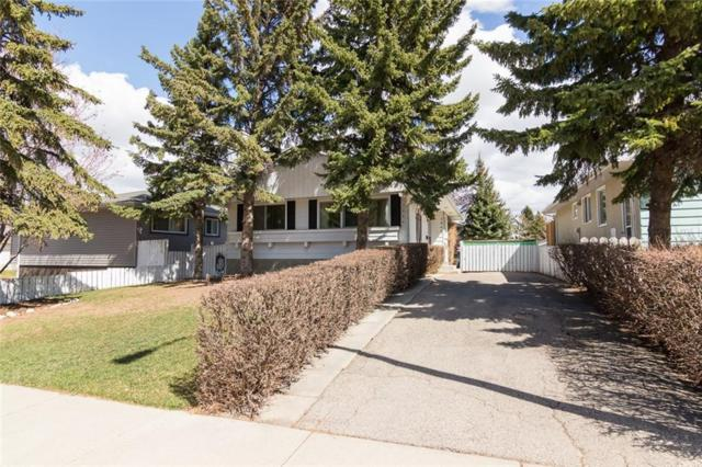 7864 Hunterburn Hill(S) NW, Calgary, AB T2K 4S8 (#C4241550) :: Redline Real Estate Group Inc