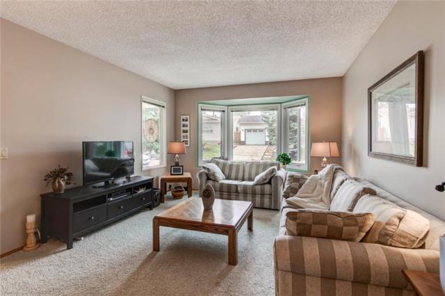 23 Woodford Crescent SW, Calgary, AB T2W 4C5 (#C4243180) :: Redline Real Estate Group Inc