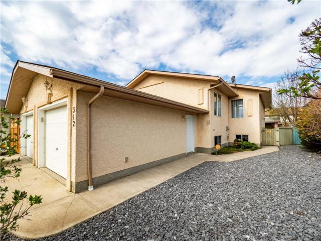 312 Strathaven Drive, Strathmore, AB T1P 1M2 (#C4243707) :: Redline Real Estate Group Inc