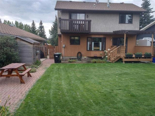 28 Woodmont Rise SW, Calgary, AB T2W 4L5 (#C4243901) :: Redline Real Estate Group Inc
