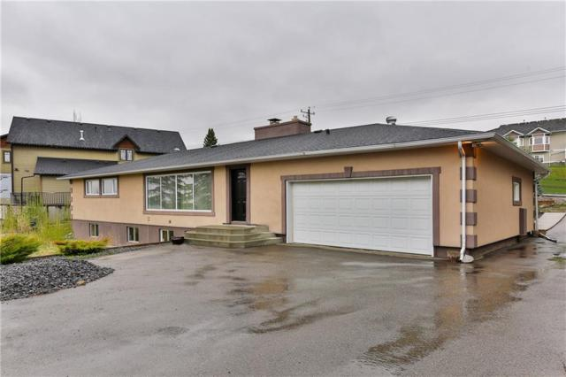 10825 Eamon Road NW, Calgary, AB T3G 5H2 (#C4245948) :: Canmore & Banff