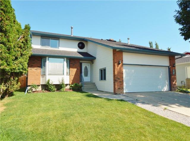 149 Woodbend Way, Okotoks, AB T1S 1L7 (#C4262676) :: Virtu Real Estate