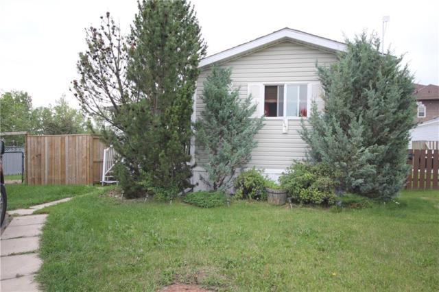 149 Heritage Drive, Okotoks, AB T0L 1T0 (#C4263100) :: Virtu Real Estate
