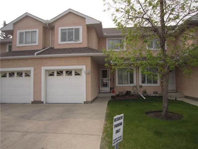 388 Sandarac Drive NW #120, Calgary, AB T3K 4E3 (#C4268309) :: Redline Real Estate Group Inc