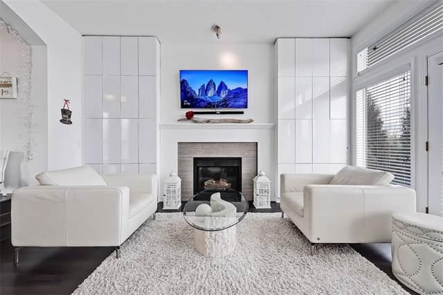 5503 Strathcona Hill(S) SW, Calgary, AB T3H 1S2 (#C4268621) :: Virtu Real Estate