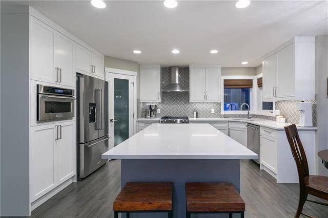 210 Tuscany Ridge Park NW, Calgary, AB T3L 2H7 (#C4271990) :: Redline Real Estate Group Inc