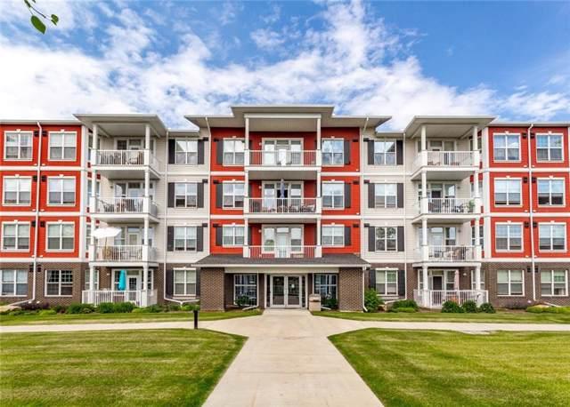 1 Crystal Green Lane #310, Okotoks, AB T1S 0C5 (#C4275422) :: Redline Real Estate Group Inc