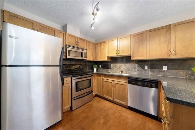 301 Village Mews SW #8, Calgary, AB T3H 2L3 (#C4277991) :: Virtu Real Estate