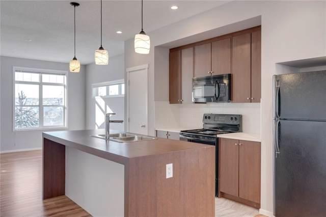 300 Evanscreek Court NW #4, Calgary, AB T3P 0B6 (#C4281501) :: Redline Real Estate Group Inc