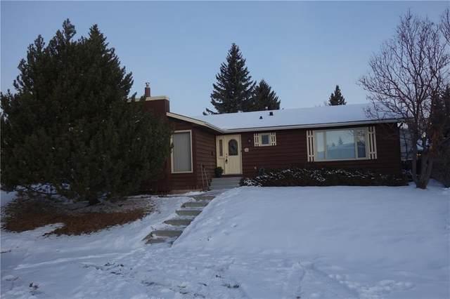 216 Woodside Bay SW, Calgary, AB T2W 3K8 (#C4282757) :: The Cliff Stevenson Group