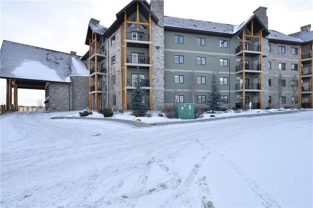 77 George Fox Trail #406, Cochrane, AB T4C 0N1 (#C4286772) :: Redline Real Estate Group Inc