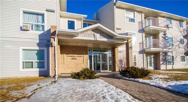5555 Falsbridge Drive NE #202, Calgary, AB T3J 3E8 (#C4288879) :: The Cliff Stevenson Group