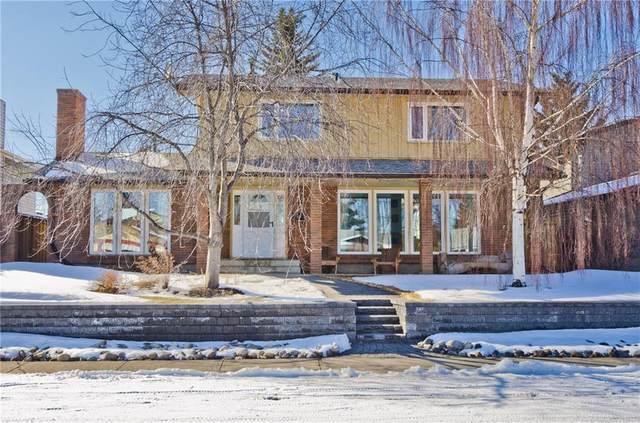 13015 Lake Twintree Road SE, Calgary, AB T2J 2X2 (#C4291954) :: The Cliff Stevenson Group
