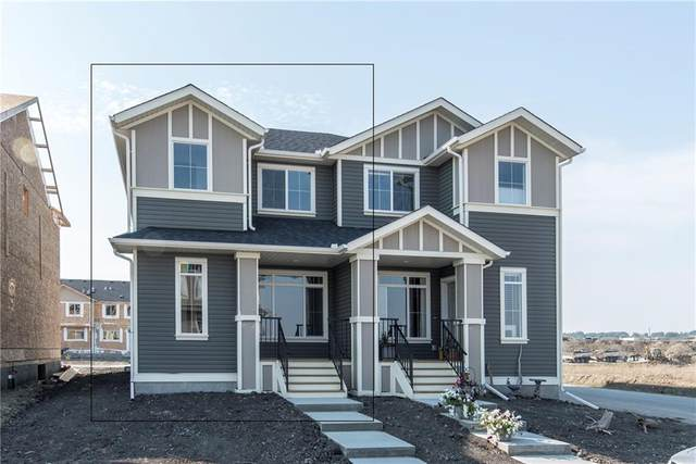Emberside Hollow #23, Cochrane, AB T4C 2L6 (#C4296765) :: Redline Real Estate Group Inc