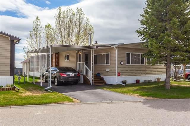 99 Arbour Lake Road NW #15, Calgary, AB T3G 4E4 (#C4297540) :: Calgary Homefinders