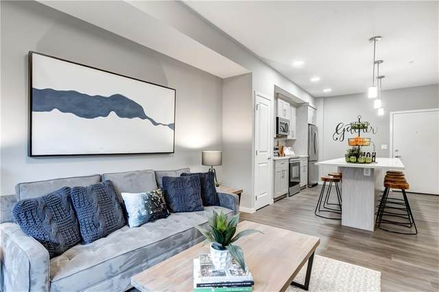 300 Harvest Hills Place NE #112, Calgary, AB T3K 2M7 (#C4297848) :: Virtu Real Estate