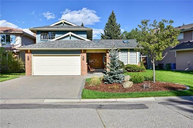 32 Woodacres Way SW, Calgary, AB T2W 4W3 (#C4300472) :: Redline Real Estate Group Inc