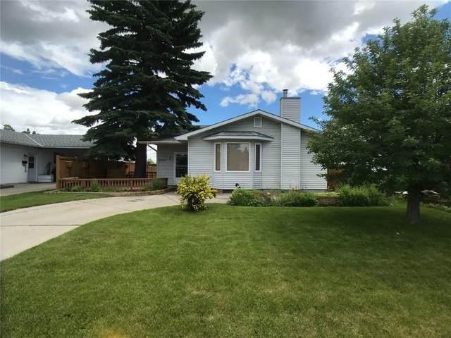 9424 Academy Drive SE, Calgary, AB T2J 1A7 (#C4305975) :: The Cliff Stevenson Group