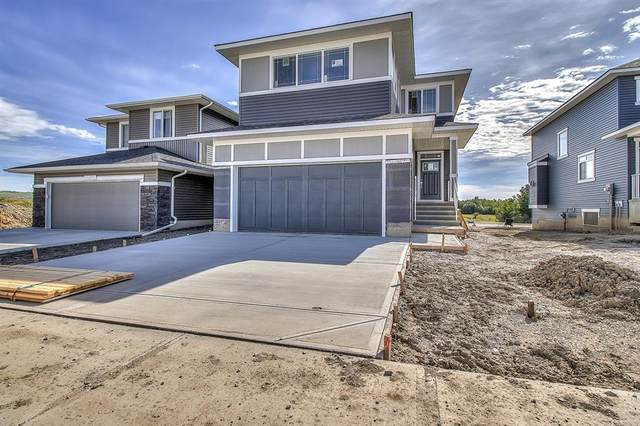 3 Rivercrest Common E, Cochrane, AB T4C 2V2 (#A1010751) :: Team J Realtors
