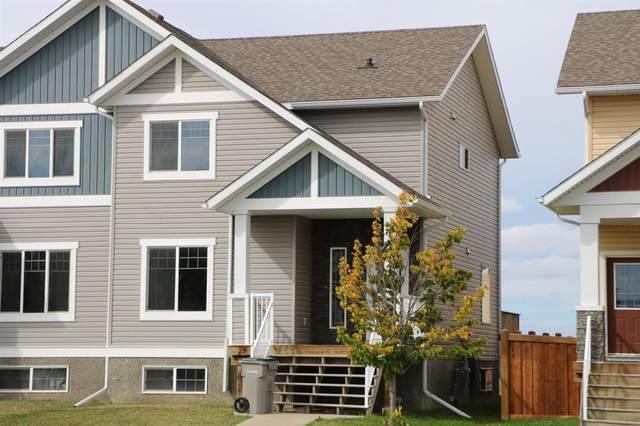 8726 72 Avenue, Grande Prairie, AB T8X 0K6 (#A1015833) :: Canmore & Banff