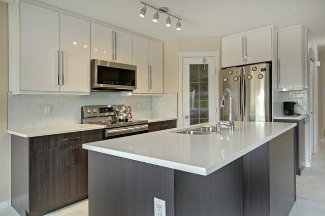 202 Cougar Plateau Way SW, Calgary, AB T3H 5S3 (#A1029793) :: Western Elite Real Estate Group