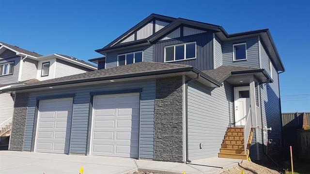 10113 84A Street, Grande Prairie, AB T8X 0S8 (#A1032649) :: Canmore & Banff